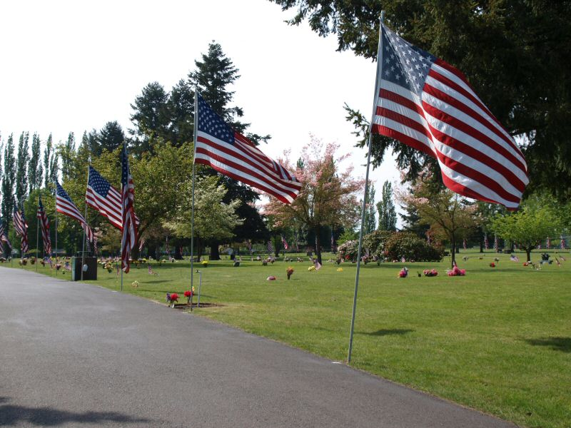 Flags line a path in the cemetery on Memorial Day