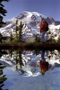 Hiker walking in front of Mt. Rainier