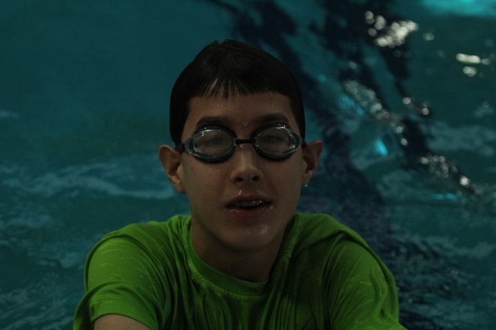 A boy wearing goggles in the pool