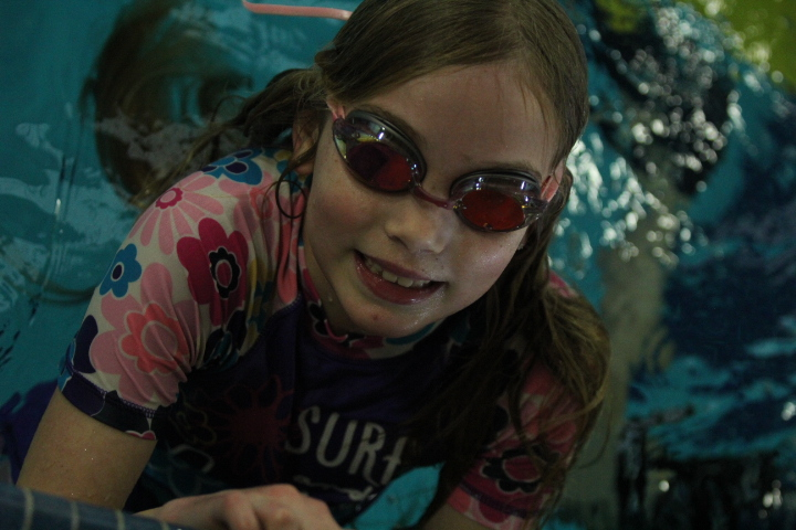 Girl wearing her goggles in the pool