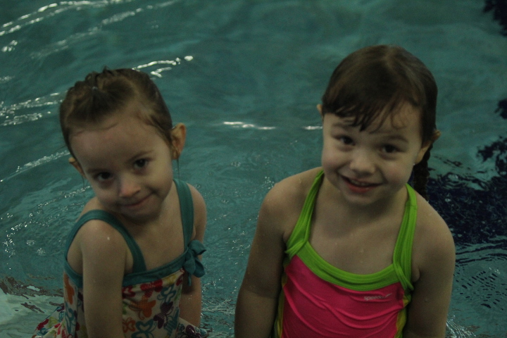 2 girls in the pool smile for the camera