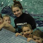 Children take a picture with the swim instructor