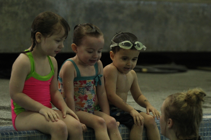 3 kids learn from the swim instructor